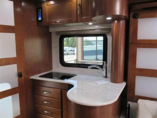 2015-pleasure-way-plateau-xl-widebody-class-b-motorhome-kitchen