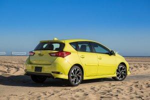 2016scionim-exterior-yellow-rearpassengerthree-quarterview